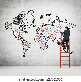 Future business developments strategy. Businessman drawing the world map and the main points to expand the business.