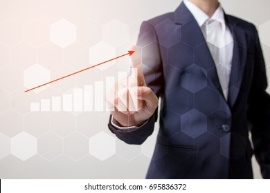Future of financial business concept,Businessman touching increasing graph with finance symbols coming.