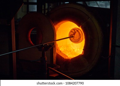 "A future glass vase is being reheat in the ""glory hole"" furnace between the steps of making it."