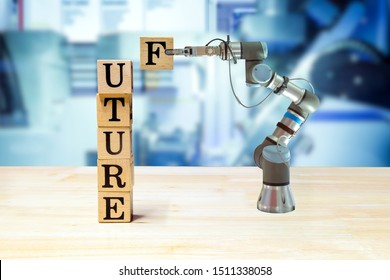 Future, Industrial gripping robot picking wooden letter for build message on wooden desk and machine blue tone color on blurred background, informative and communication about industry 4.0 concept