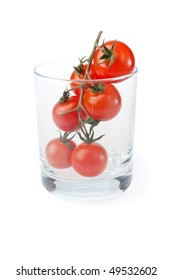 Future juice - bunch of cherry tomatos in a glass, isolated on white.