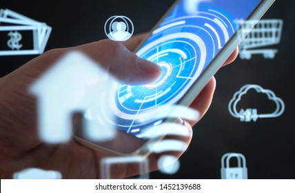 Future mobile phone technology to control smart home. Cellphone app interface with abstract IOT and AR data. Futuristic augmented reality tech in smartphone. Man using house automation software.