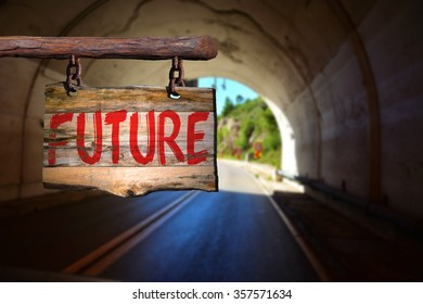 Future motivational phrase sign on old wood with blurred background
