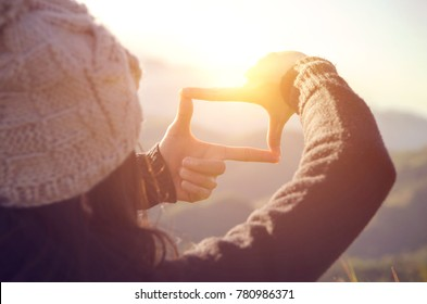 Future planning, Close up of woman hands making frame gesture with sunrise on mountain, Female capturing the sunrise, sunlight outdoor. - Shutterstock ID 780986371