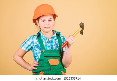 Future profession. Builder engineer architect. Kid builder girl. Build your future yourself. Initiative child girl hard hat helmet builder worker. Tools to improve yourself. Child care development.