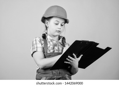 Future profession. Kid builder girl. Build your future yourself. Initiative child girl hard hat builder worker. Child care development. Safety expert. Foreman inspector. Builder engineer architect.