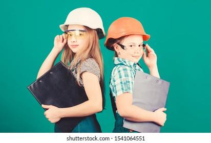 Future profession. Kids girls planning renovation. Initiative children girls provide renovation their room green background. Child care. Renovation plan. Home improvement. Builder engineer architect.