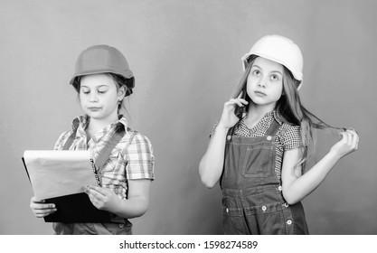 Future profession. Kids girls planning renovation. Initiative children girls provide renovation their room green background. Renovation plan. Home improvement activities. Builder engineer architect.