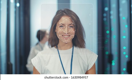 Future Technology. Face ID. Facial Recognition. Biometric Face Detection. 3D Technological Identification Scanning of Face of Smiling Cheerful Woman Server Specialist in Computer Security Data Center