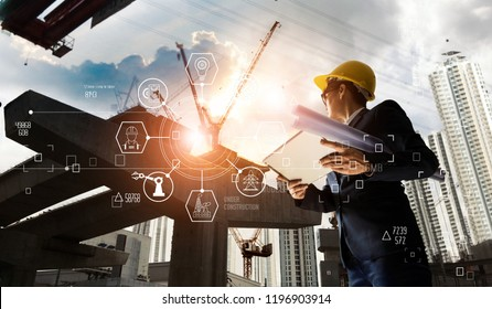 A futuristic architect, Businessman, Industry 4.0. Engineer manager using tablet with icon network connection in construction site, Industrial and innovation. Industry technology concept.