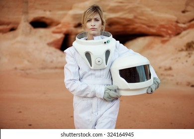 futuristic astronaut without a helmet on another planet, image with the effect of toning