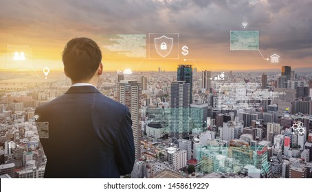 Futuristic augmented reality online data and cyberspace, Businessman looking at the city with futuristic online data hologram