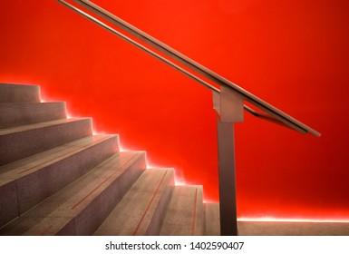 Futuristic backlit modern office staircase.