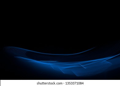 Futuristic blue abstract light line on black background. Blue abstract background.
