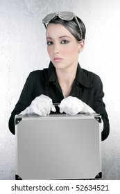 futuristic businesswoman holding silver briefcase fashion short hair brunette
