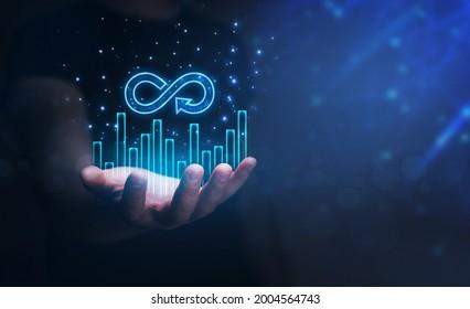 Futuristic Circular economy concept. Businessman holding in hand growth graph  and Circular economy symbol.