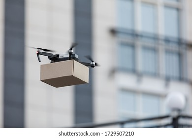 Futuristic delivery. Drone cargo delivery concept, fast air shipment, copy space, blurred background