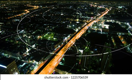 Futuristic digital broadcasting, gps location signals and data connectivity in the cityscape at night time