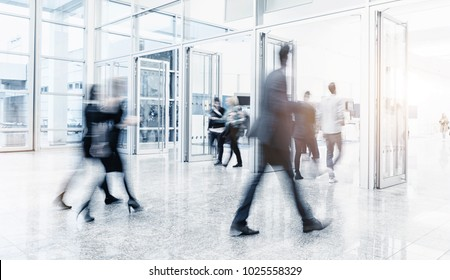 Futuristic environment with blurred people at a trade show