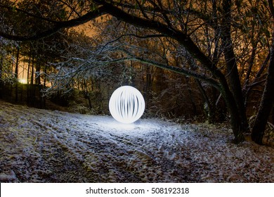 Futuristic glowing sphere on a background of a beautiful winter landscape in full moon