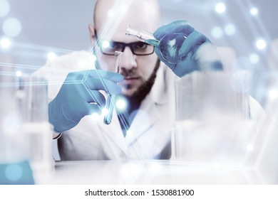 In a futuristic laboratory, a scientist with a pipette analyzes a colored liquid to extract the DNA and molecules in the test tubes.Concept:research,biochemistry,immersive technology,augmented reality