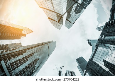 futuristic landscape of silhouettes of skyscrapers in the city. toning image. Focus on the tops of skyscrapers