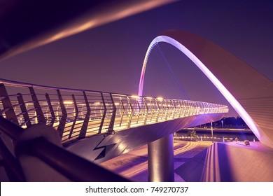 Futuristic modern design bridge at night with the light on