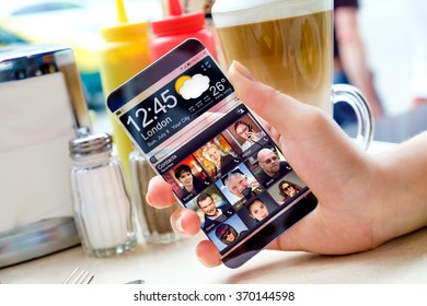 Futuristic Smart phone with a transparent display in human hands. Concept actual future innovative ideas and best technologies humanity.