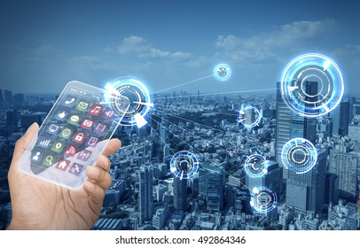 futuristic smart phone and wireless communication network, smart city, Internet of Things, abstract image visual