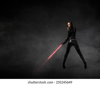 futuristic soldier with red laser sword