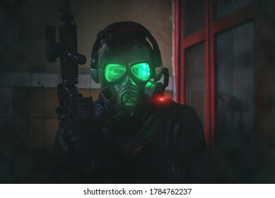 Futuristic soldier with a rifle in a gas mask.