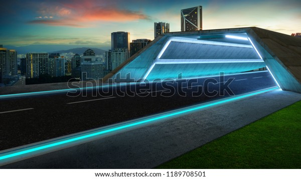 Futuristic style highway tunnel road with blue neon light and cityscape background .