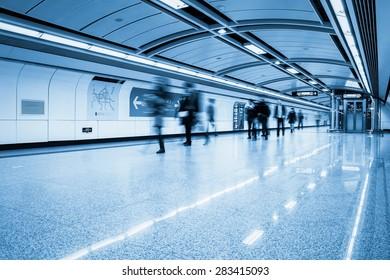 futuristic subway passage with passengers motion blur in guangzhou
