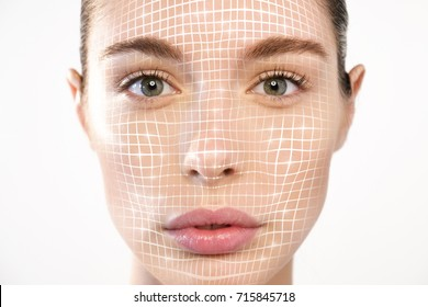 Futuristic and technological face scanning of a beautiful woman for facial recognition and facial lifting for rejuvenation. It can serve to ensure personal safety. Concept of: future,security,scanning