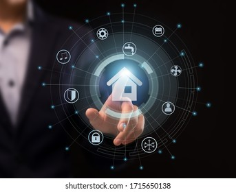 Futuristic technologies concept. Collage with male hand pushing SMART HOME pictogram on imaginary screen