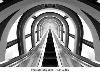 Futuristic tunnel and escalator of steel and metal, interior view