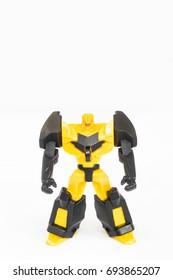 Futuristic yellow robot on white background.