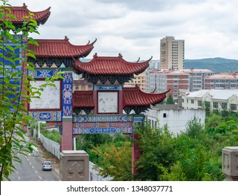 Fuyang/China 08.10.2019: Arch before the entrance to city Park. Traditional structure.
