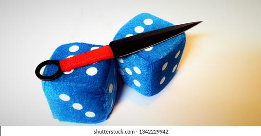 Fuzzy dice and ninja knife