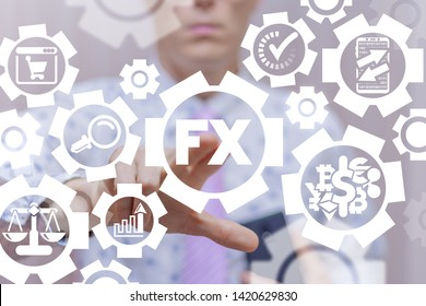 FX Foreign Exchange Market Financial concept. Businessman uses on a virtual screen of the future and touches the acronym: FX.