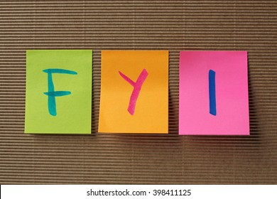 FYI (For Your Information) acronym on colorful sticky notes