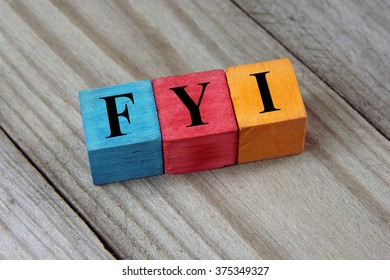 FYI (For Your Information) text on colorful wooden cubes