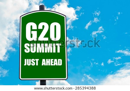 G20 SUMMIT Just Ahead written on green road sign  against clear blue sky background. Concept image with available copy space