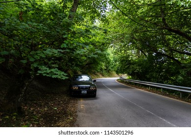 Gabala city, Nij village, Azerbaijan - 07.12.2018: BMW E39. Angel eyes. Shooting in the forest with manual lens
