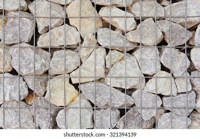 Gabion in close-up; Cage filled with rocks