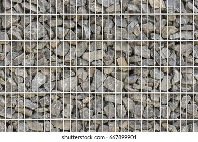 Gabion fence wall. Simple fence made of natural stone.