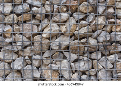 Gabion fence wall from steel mesh with stones