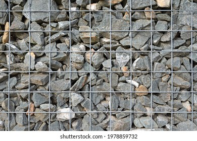 Gabion filled with crushed stone