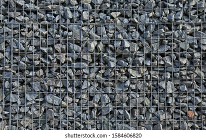 Gabion, texture, background. Gabion net frequent part (design). New technologies in the manufacture of retaining walls and fences. Landscaping. Fencing decorative elements