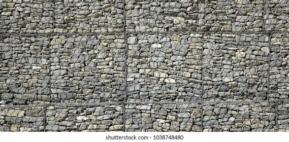 Gabion Wall From Rocks And Stones In Metal Wire Box. Reinforcement and Abutment Protective Construction. Abstract Web Banner